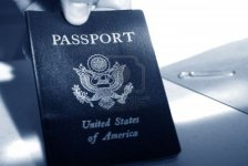 2470961_male_hand_holding_an_american_passport_in_blue_tone_color